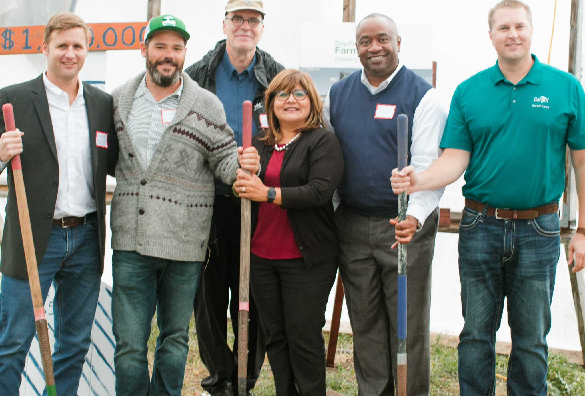 Pictured from left to right, David Schleicher {Prairie Design Build} , Johnny Gordon {BoysGrow} , Mark McHenry {McHenry Schaffer Architects}, Adriana Pecina {KC Health Care Foundation}, Mark Garrett {Smithfield Foods} & Ryan Murdock {Cargill}.  All Ready for Action....